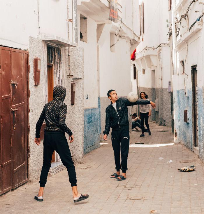 FULL LENGTH OF PEOPLE WALKING IN CITY BUILDINGS
