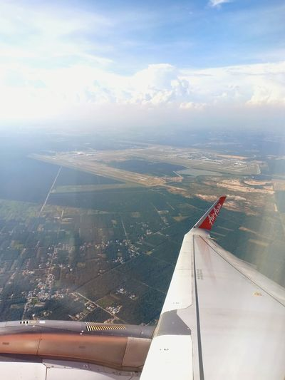 Malaysia/Thailand Airasia AirAsiaMalaysia AirAsiaThailand The Traveler - 2018 EyeEm Awards Water Sea Aerial View City Cityscape Sky Cloud - Sky Aircraft Wing Air Vehicle Airplane Aircraft