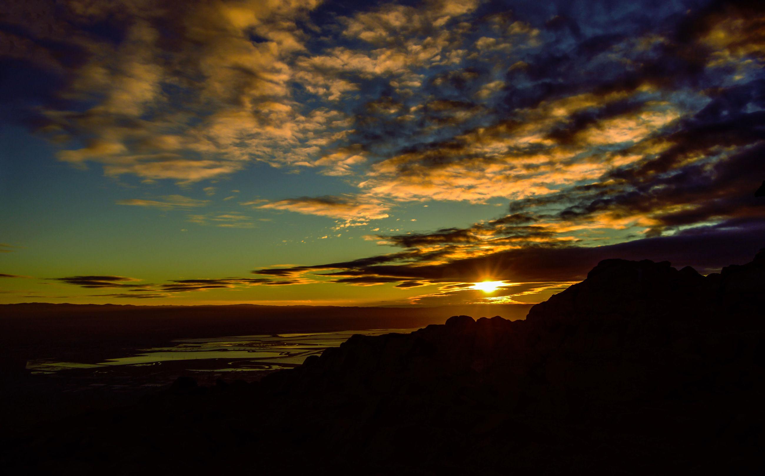 sunset, scenics, silhouette, tranquil scene, sky, beauty in nature, tranquility, cloud - sky, idyllic, orange color, dramatic sky, nature, cloud, dark, majestic, moody sky, cloudy, landscape, atmospheric mood, sun