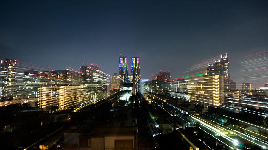 Stunning view on the shinjuku skyline while zooming out creating awesome light trail effects