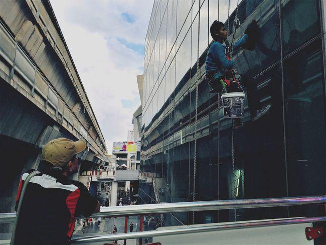 Gazing People Watching Window Cleaner Job