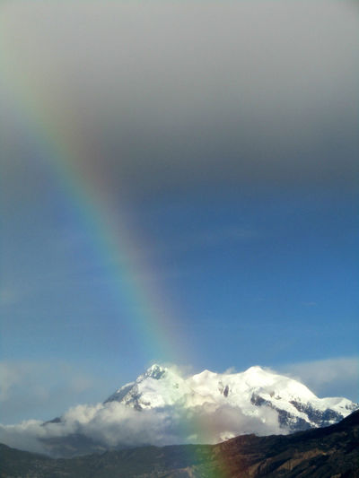 Rainbow with Illimani in the background. La PAz, Bolivia. Beauty In Nature Cloud - Sky Cold Temperature Day Illimani Mountain Nature No People Outdoors Rainbow Scenics Sky Snow Snowcapped Mountain Weather Winter