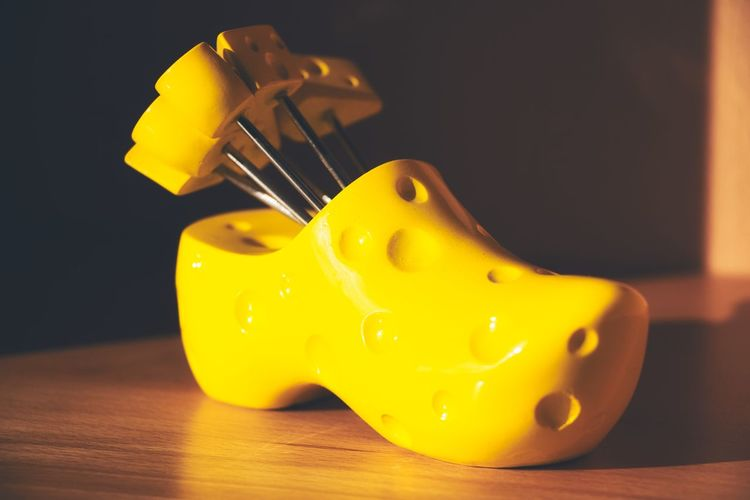 Close-up of yellow toys on table