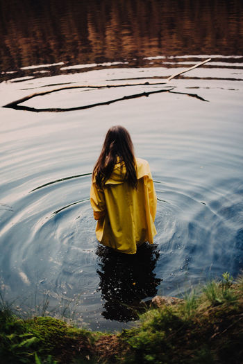 Animal Themes Bavaria Beauty In Nature Day From Behind Girl Lake Long Hair Melancholic Nature Outdoors Raincoat Reflection Water Wet Woman Yellow Raincoat