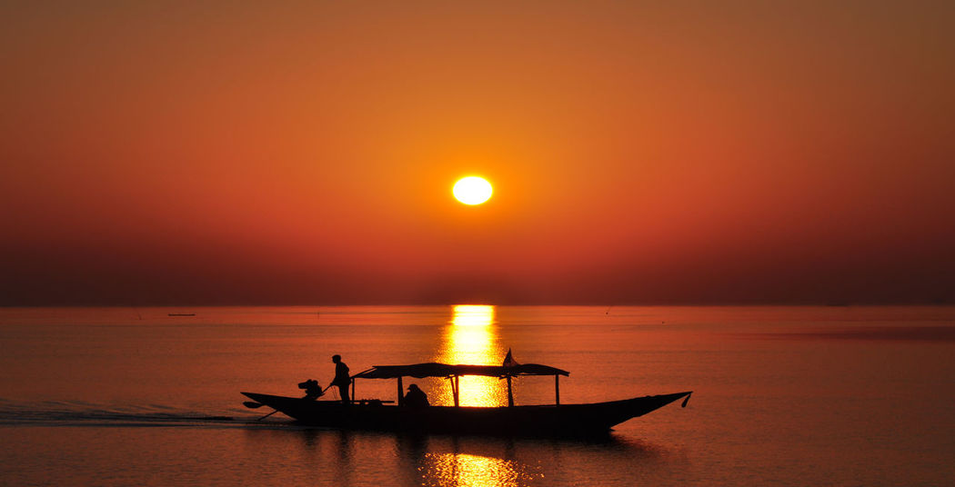 sunset at Barkul Beauty In Nature Horizon Over Water Orange Color Reflection Sea Silhouette Sky Sun Sunset Tranquility Water
