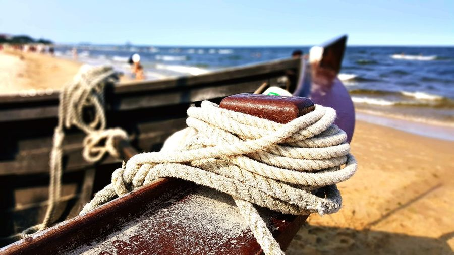 Close-Up Of Rope Tied On Boat Moored At Harbor