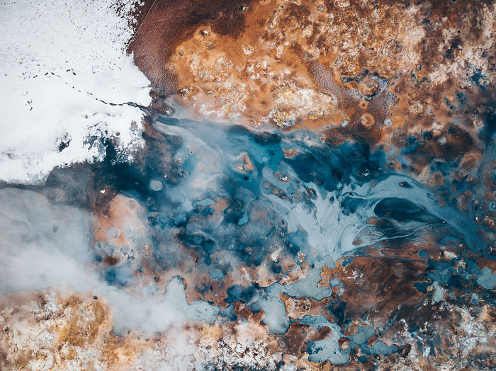 Abstractions of nature. Iceland, Hverir geothermal spot noted for its bubbling pools of mud & steaming fumaroles emitting sulfuric gas. Aerial Shot Colors DJI Mavic Pro DJI X Eyeem Geothermal Fields Hot Myvatn Nature Abstract Abstractions Aquatic Sport Art Of Nature Beauty In Nature Close-up Day Geology Heat - Temperature Hverir Iceland_collection Mavic Pro Motion Mud Nature No People Outdoors Pool Power Power In Nature Rock Rock - Object Sea Shapes And Forms Snow Solid Top Down View Water Winter