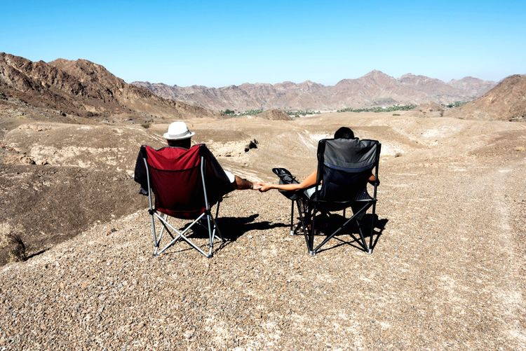 Together in the desert of rocks! Couple enjoying the view that n Wadi Al Ghail, United Arab Emirates 🇦🇪 Rear View Real People Clear Sky Two People Sitting Outdoors Togetherness Men Day Women Beauty In Nature Nature Leisure Activity Mountain Sky Scenics Beauty In Nature Trekking Nature Isolated Desert Camping Outdoors Second Acts An Eye For Travel