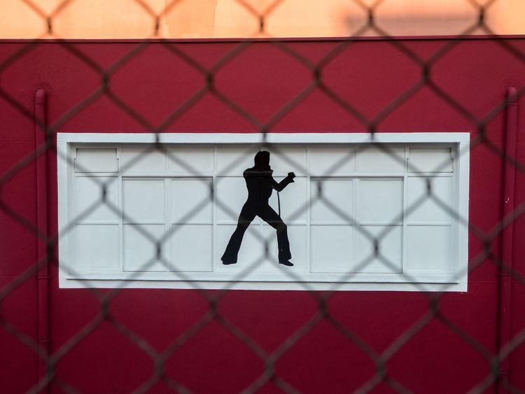 Elvis is not dead Sillhouette Elvis Elvis Presley Grafitti Fence Barrier Outdoors Day