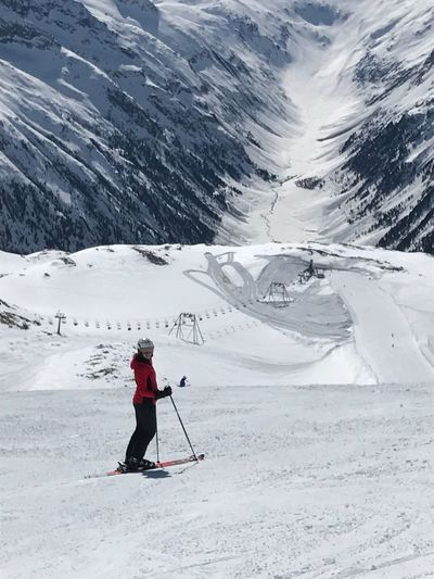 Full length of woman skiing on snowcapped mountain