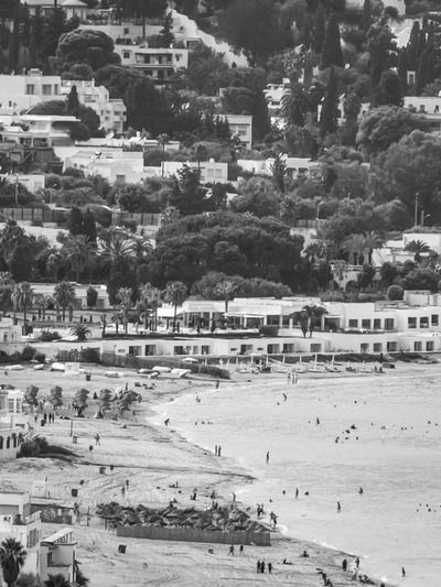High angle view of townscape by beach