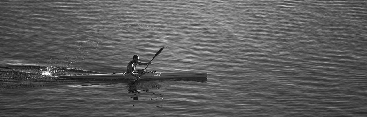 Beauty In Nature Black & White Black And White Blackandwhite Boat Condado La Day Fast Kayak Laguna Condado Men Nature Outdoors Puerto Rico Real People San Juan San Juan PR Sea Spray Water Water Reflections Waterfront