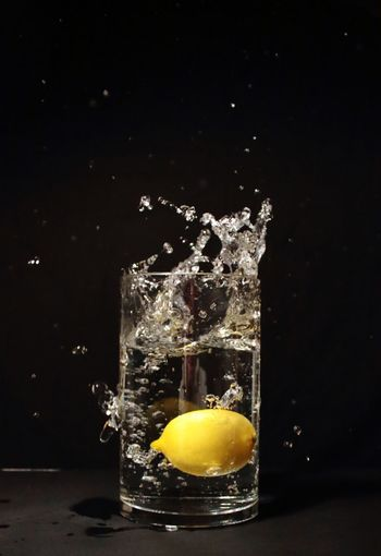 freeze the moment Freeze The Moment Art Passion Beautiful Action Lemon Water Glass Time Set Yellow Black EyeEm Selects EyeEm Gallery EyeEm Black Background Yellow Motion Studio Shot Colliding Impact Splashing Liquid Egg Yolk Close-up Calm