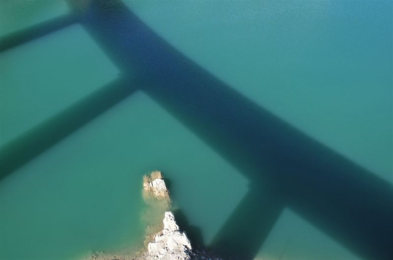 High angle view of shadow on water