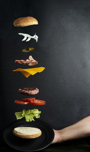 Low angle view of vegetables on table against black background