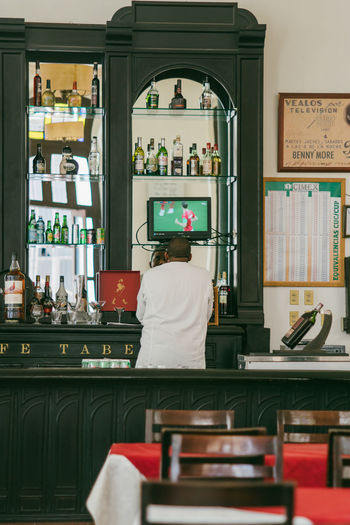 We watched the Worldcup in Cuba~ Adult Architecture Bar Counter Business Casual Clothing Chef Food Food And Drink Indoors  Lifestyles Love The Game Men Occupation One Person Real People Rear View Restaurant Seat Shelf Sitting Table Women