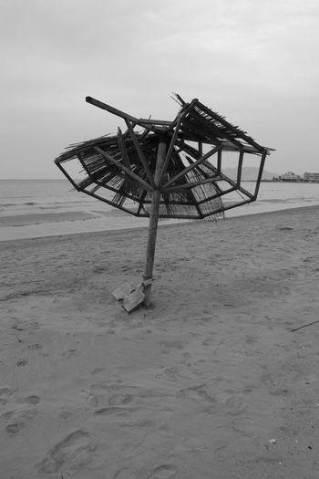 Destroyed No People Sky Umbrella Sea Beach Sand Photography