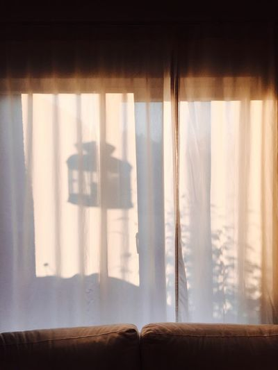 Close-up of shadow on curtain at home