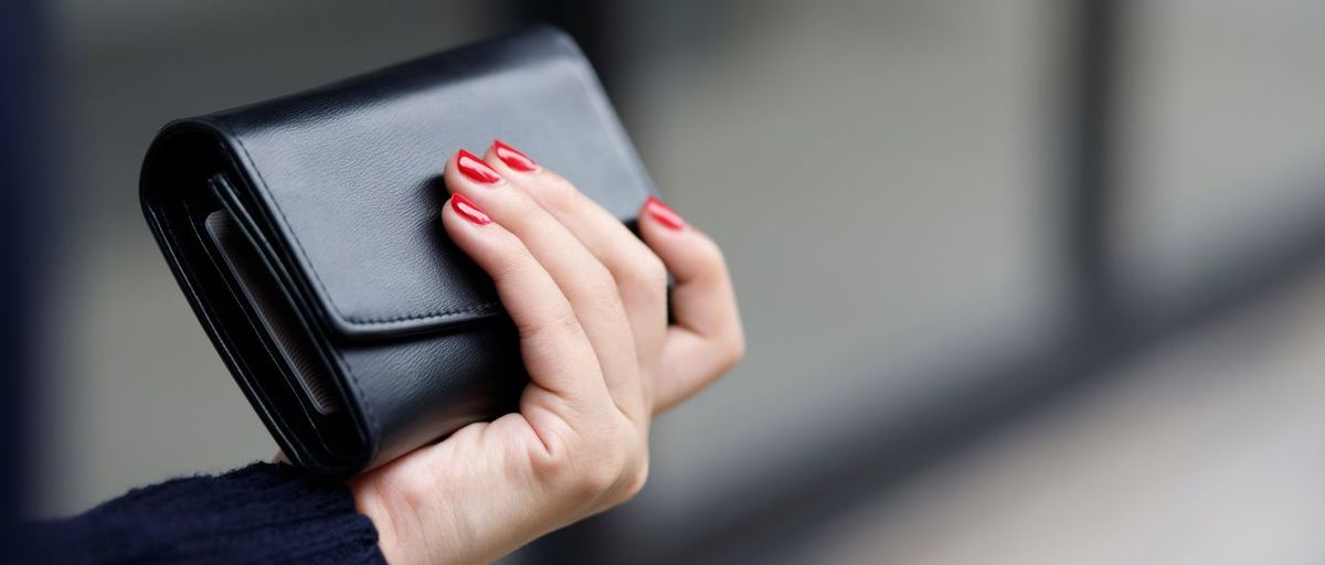 Close-up of woman hand holding smart phone
