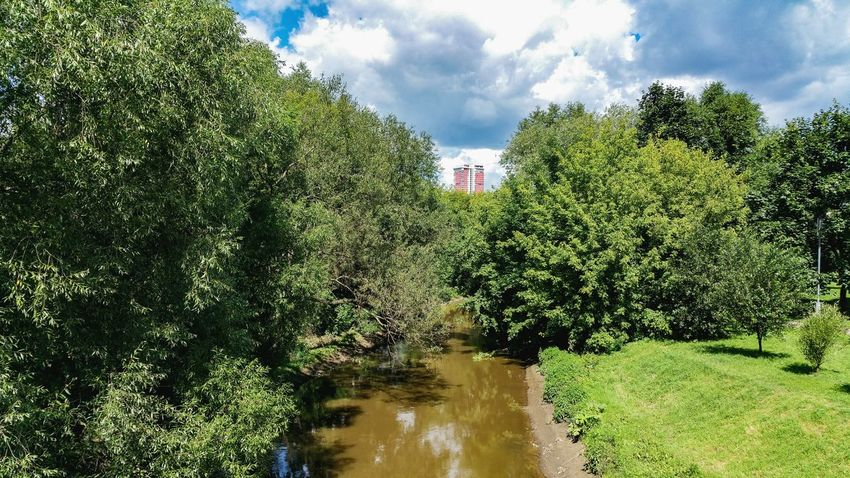 Water Outdoors Day No People Summer City река Tree Architecture Cityscape Russia Москва Moscow Яуза Landscape River Skyscraper Colorful Park Travel Destinations Park - Man Made Space City Life Built Structure Beauty In Nature Tree
