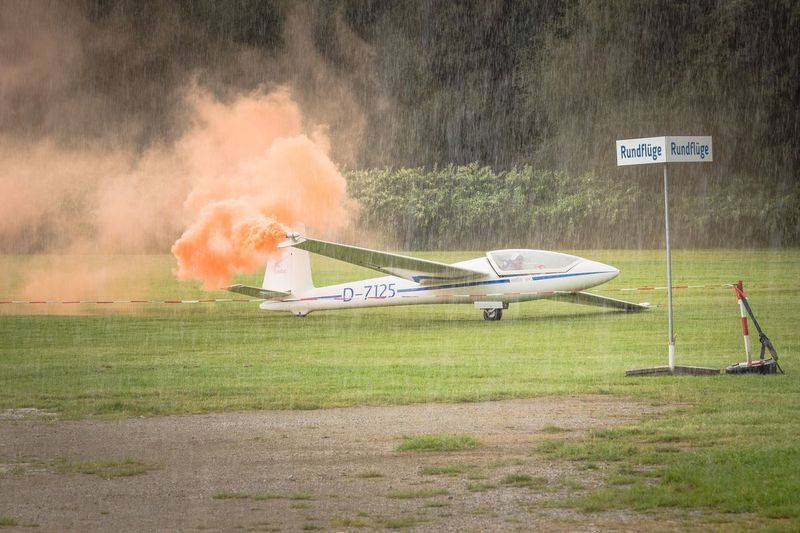 Airplane Grass Transportation No People Outdoors Day Smoke Orange Smoke Rain