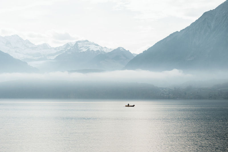 calm mornings at the lake Mountain Scenics - Nature Beauty In Nature Tranquil Scene Water Tranquility Waterfront Mountain Range Sky Fog Nature Non-urban Scene Cloud - Sky Lake Outdoors Foggy Mist Mountain Peak Mountain View Lake View Lakeside Boat Fisherman Calm Calmness