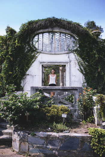 Adult Adults Only Architecture Built Structure Day Greenhouse Indoors  Ivy Nature One Person People Plant Sky Transparent Tree Water Window