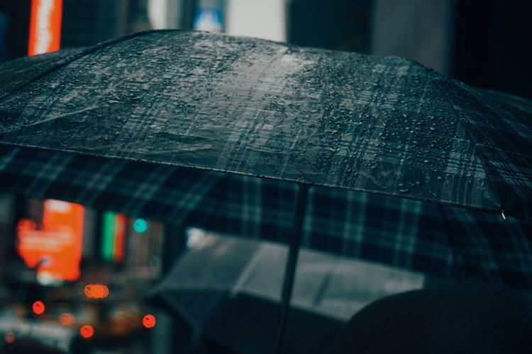 Close-Up Of Wet Umbrella In City At Night