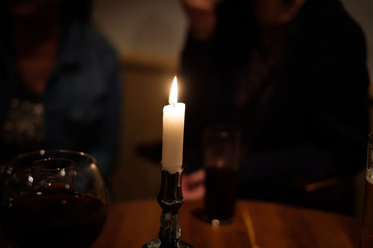 Friends Pub Belief Burning Candle Close-up Cosy Place Dark Domestic Room Evening Fire Fire - Natural Phenomenon Flame Focus On Foreground Glowing Heat - Temperature Holding Illuminated Incidental People Indoors  Nature Religion Selective Focus Spirituality Whine Glass