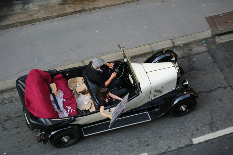 High Angle View Of Man Driving Vintage Car