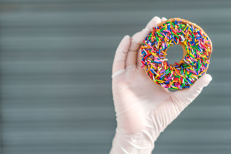 Close-up of hand holding donut