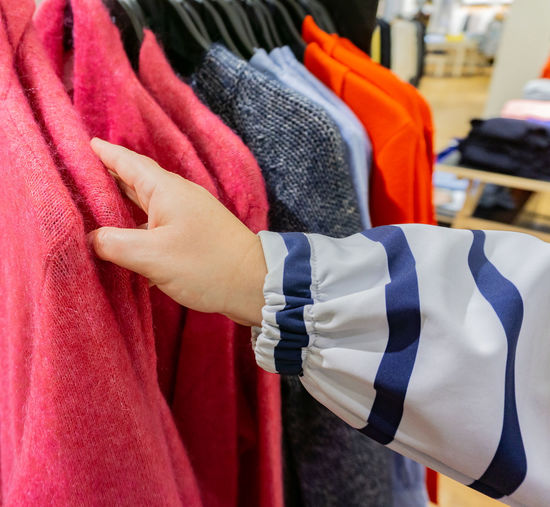 Cropped Hand Choosing Cloth At Store