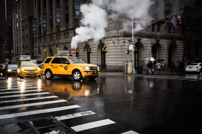 Yellow taxi crossing the street New York New York City Taxi Dust Rainy Days Yellow