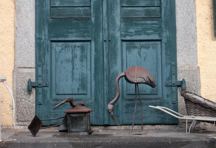 Sculpture Of Bird By Door