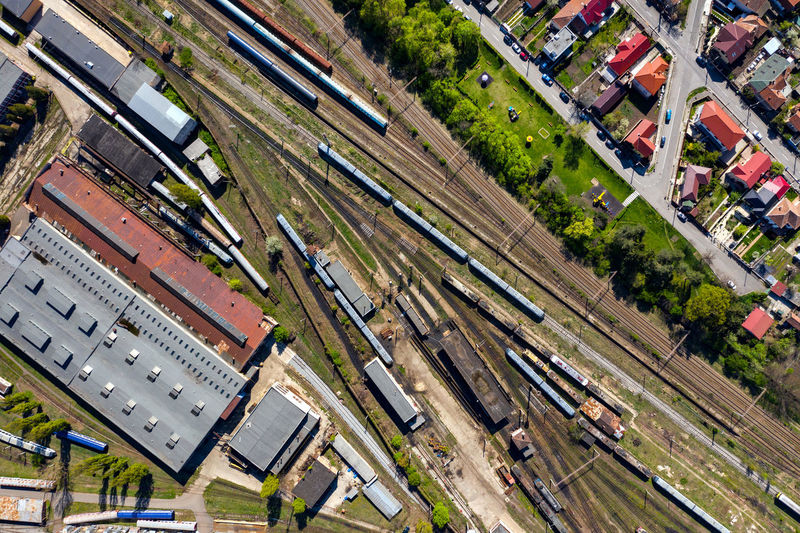 Aerial drone view of old locomotive train depo, parking iron horses on railway routes. Diesel engine Abandoned Diesel Engine Drone  Railway Aerial Transportation Locomotive Depot Transport Railroad Train Track Rail Cargo Station Industrial Industry Travel Urban Carriage View Transit Wagon  Above Platform Freight City Commercial Container Vehicle Terminal Shipment Traffic Shipping  Metal Top View Junction Steel Business Direction Way Perspective Departure Logistic Delivery Infrastructure Subway Commute