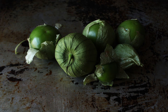 Tomatillo Tomatillos Mexican Husk Tomato Nightshade Salsa Ingredient Cooking Gourmet Dark Green Close Up Selective Focus Rustic Food And Drink Freshness Still Life Healthy Eating Green Color Vegetable Close-up Raw Food Indoors