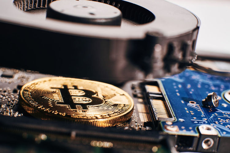 Close-up of bitcoin with computer equipment