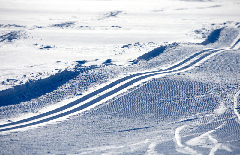 Aerial view of tire tracks on snow