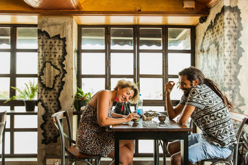 People having fun at a cafe in South Delhi. Couple In Cafe, Cozy Cafe In Delhi Cafes In Hauz Kh Indian Cafes. Foreigners In Cafe Leisure Time In Cafe Couple Having A Leisure Time South Delhi