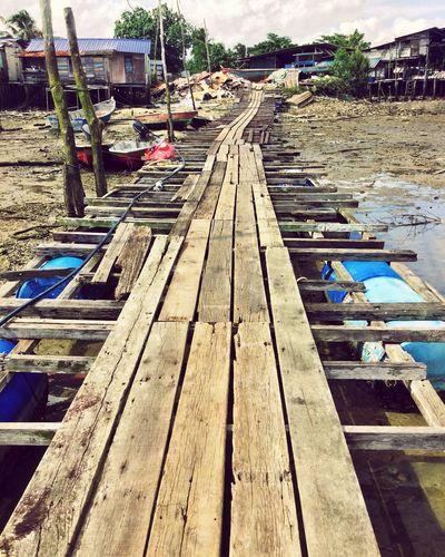 Malaysia Johor Bahru Fishing Village Pier Rickety Ramshackle Low Tide
