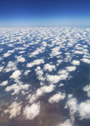 Clouds over landscape. Clouds Cotton Balls Curvature Of The Earth Vertical Sky Beauty In Nature Cloud - Sky Tranquility Scenics - Nature Nature No People Blue Sunlight Aerial View Cloudscape High Angle View Landscape