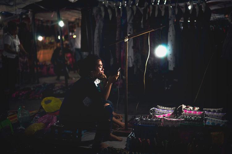 Woman using smart phone at market