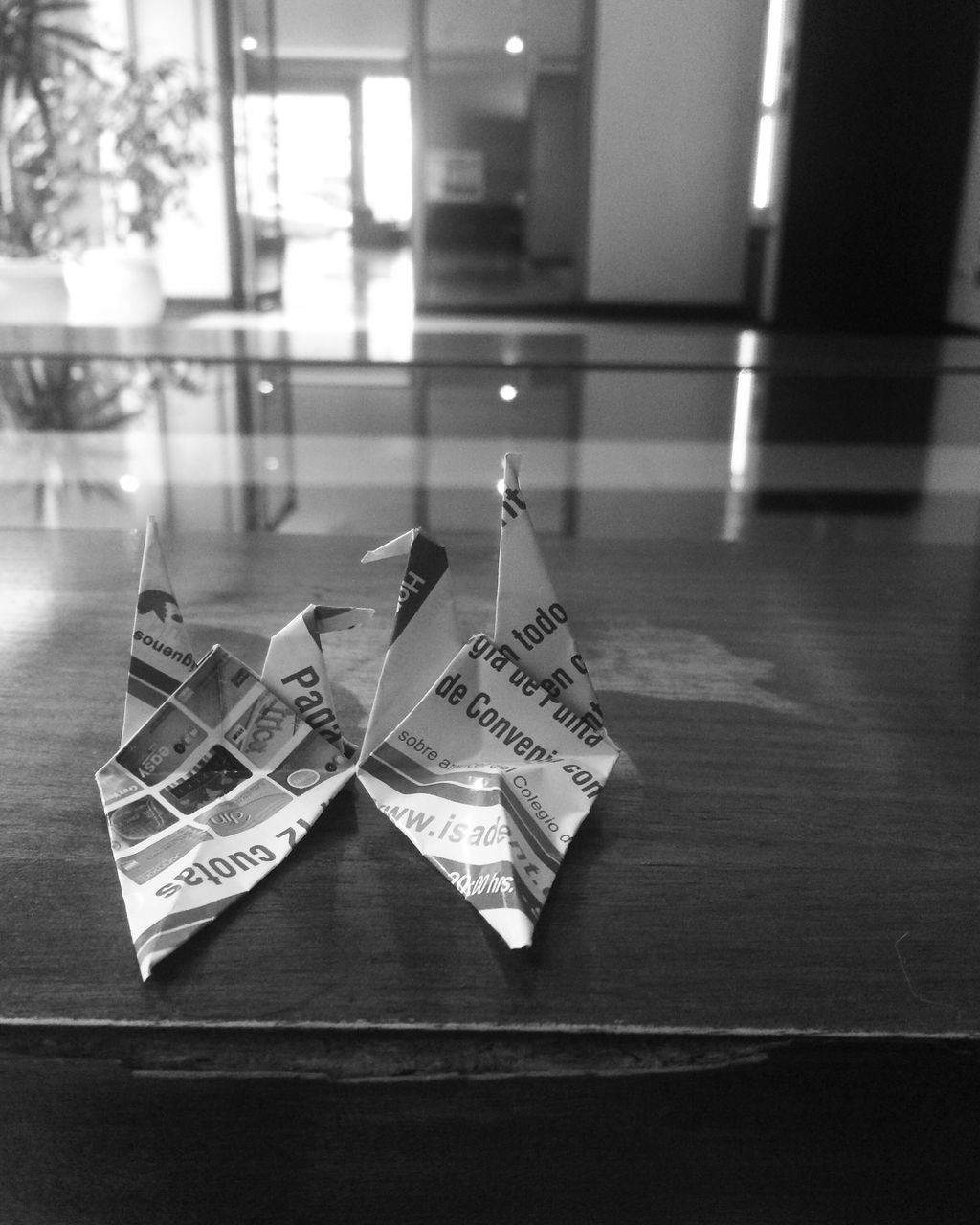 indoors, no people, table, still life, paper, close-up, creativity, communication, focus on foreground, finance, text, origami, art and craft, business, flooring, glass - material, representation, wealth, transparent