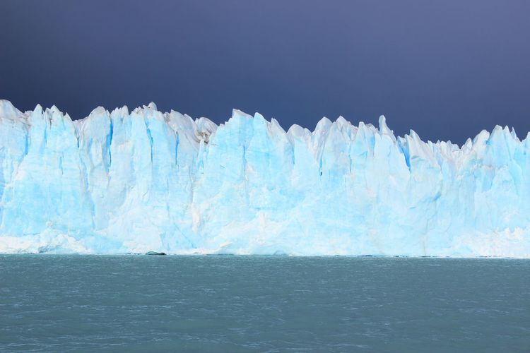 Icebergs And Sea Against Clear Sky