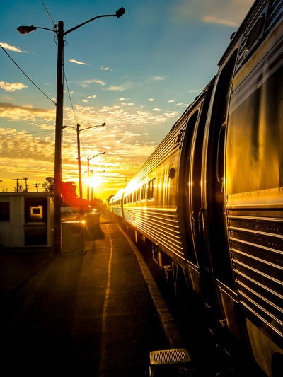 Sky Transportation Sunset Mode Of Transportation Rail Transportation Cloud - Sky Public Transportation Train Nature No People Train - Vehicle Architecture Outdoors Sunlight Travel Railroad Station City Land Vehicle The Way Forward Track