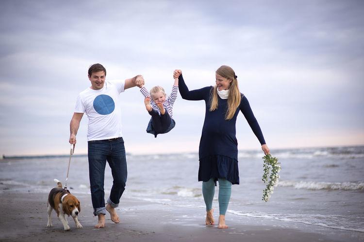 Full length of happy family at beach