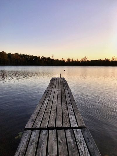 Water Nature Lake Pier Tranquility Tranquil Scene Scenics Outdoors Wood - Material Beauty In Nature Sky Tree No People Sunset Clear Sky Day Wood Paneling EyeEm Vision