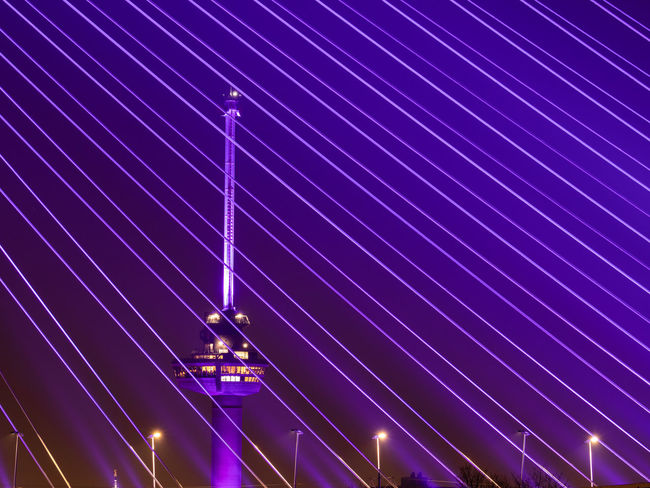 Illuminated Night Lighting Equipment Blue Purple No People Light - Natural Phenomenon Glowing Low Angle View Nightlife Motion Speed Long Exposure Light Architecture Outdoors Technology Built Structure Electricity  Fuel And Power Generation Laser Ceiling