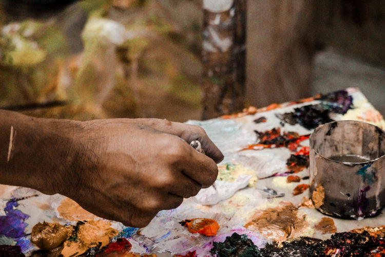 Close-up of person holding paint