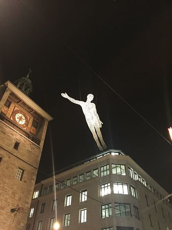Geneva Center Clock Tower Christmas Decoration Winter Decoration Winter Time Geneva City Decoration Art Flying Man Architecture Built Structure Building Exterior Night Low Angle View Statue Sculpture No People City Outdoors Travel Destinations Sky